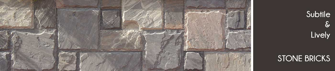 Natural stone wall tiles applications at outdoor elevation for Exterior wall tiles design india