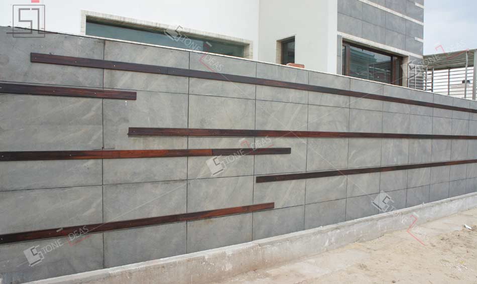 Application of natural stone on interior exterior walls floor for Exterior stone wall house design